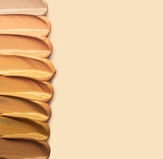 Make-up crème foundation geïsoleerd op beige