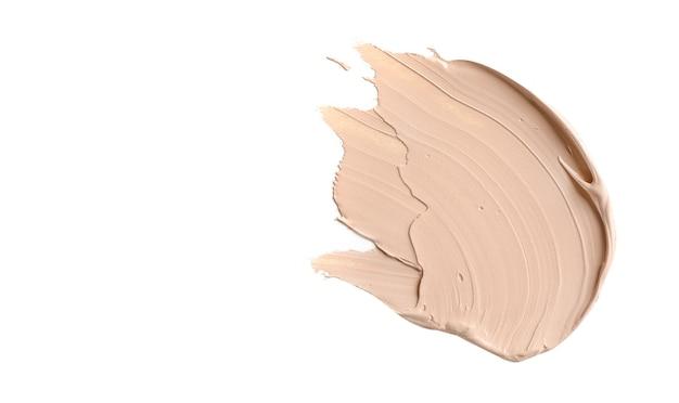 Make-up foundation, cosmetische crème uitstrijkje geïsoleerd op wit