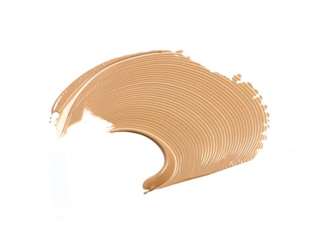 Make-up foundation staal vlek uitstrijkje geïsoleerd op wit