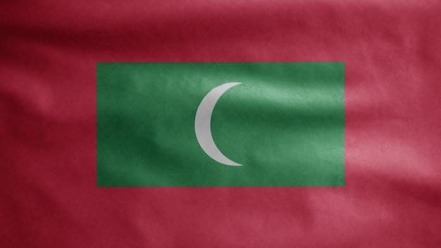 Maldivische vlag zwaaien in de wind. maldiven banner waait zachte zijde. doek stof textuur vlag achtergrond