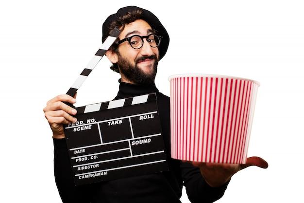 Man die een klepel en popcorn