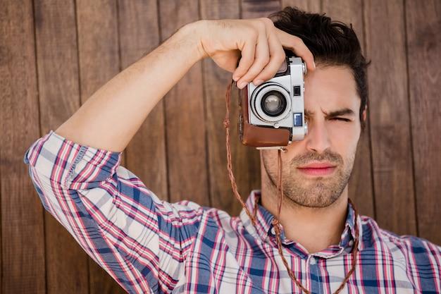 Man fotograferen met camera