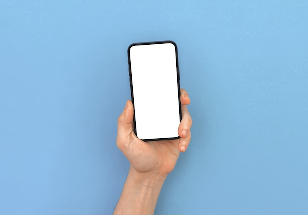 Man hand houdt moderne mobiele telefoon mockup op heldere pastel en kleurrijke achtergrond, kopieer ruimtefoto