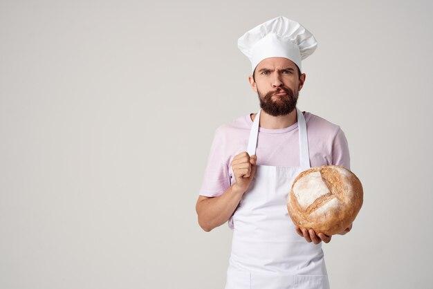 Man in kokskleren bakker meel producten koken werk. hoge kwaliteit foto