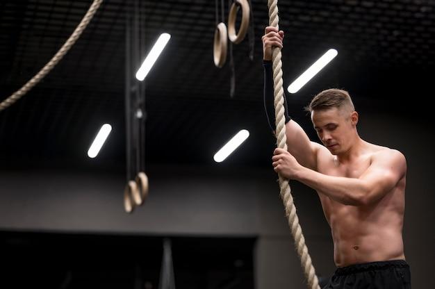 Man klimmen op touw