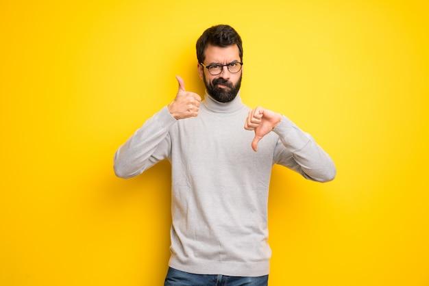 Man met baard en coltrui maken goed-slechte teken. onbeslist tussen ja of nee