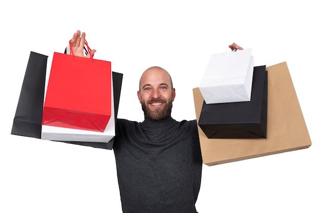 Man met boodschappentassen in zijn handen kijkend naar camera op witte achtergrond black friday sales