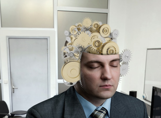 Man met constructie van lager in zijn hersenen op kantoor