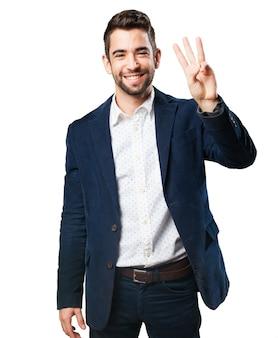 Man met drie vingers opgeheven