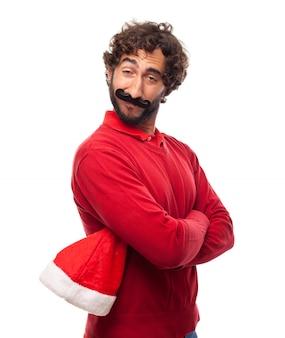 Man met hoed van de kerstman in een hand