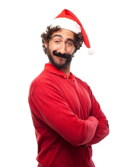 Man met hoed van de kerstman met gekruiste wapens