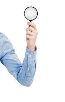 Man's hand met vergrootglas