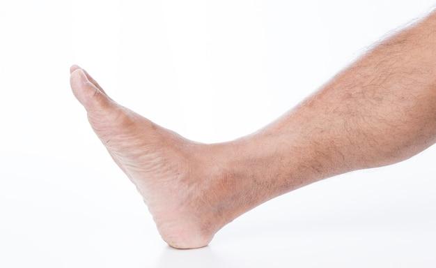 Man voet op witte achtergrond