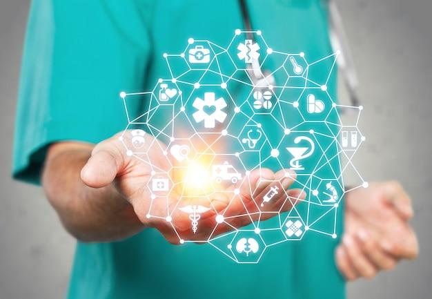 Mannelijke hand met medische pictogrammen, gezondheidszorgconcept