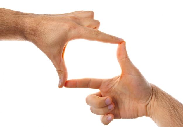 Mannelijke handen die frame maken