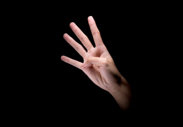 Mannelijke handen met viervingerig teken