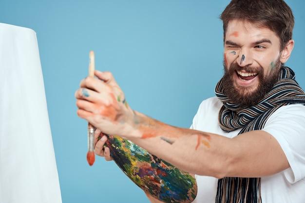 Mannelijke kunstenaar palet penseel ezel kunst hobby blauw.