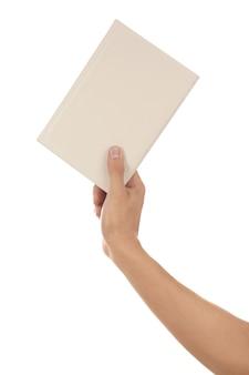 Mannenhand met boek op wit