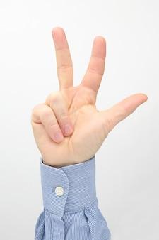 Mannenhand met drie vingers uitgespreid