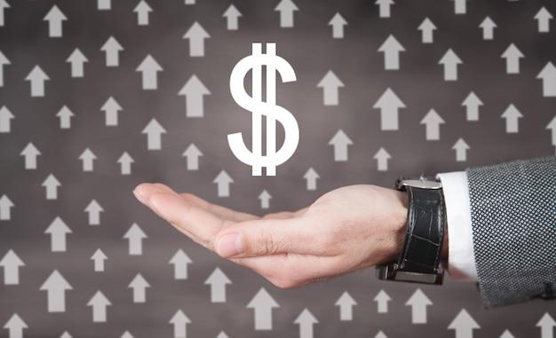 Mannenhand weergegeven: dollarteken met een groeiende pijlen.