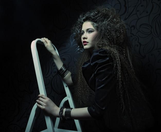 Mannequin op een ladder