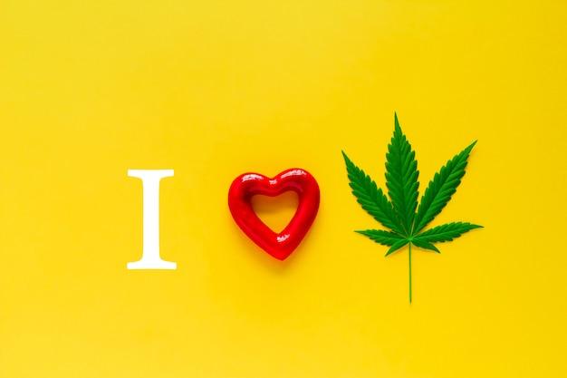Marihuana en rood hart op een gele achtergrond,