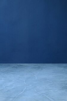 Marineblauwe cement en cementvloer, binnenlandse behangachtergrond, concrete behangachtergrond