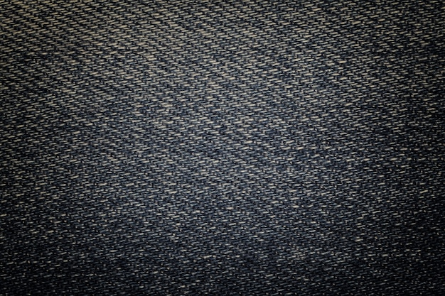 Marineblauwe sjofele denim textiel close-up als achtergrond. geweven stof macro