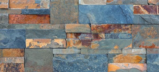 Marmeren geconfronteerd met tegel, textuur. natuurlijk bouwmateriaal.
