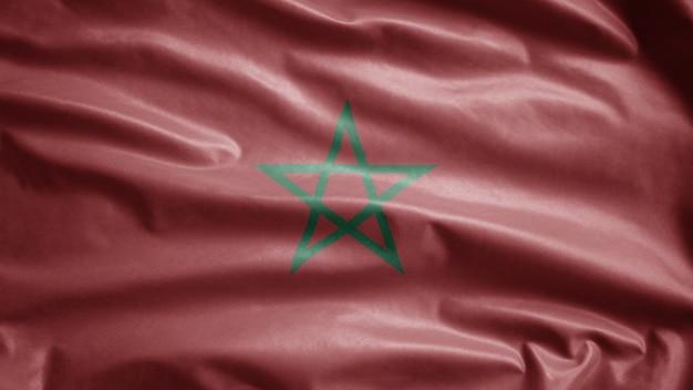 Marokkaanse vlag wappert in de wind. marokko spandoek waait, zachte en gladde zijde.