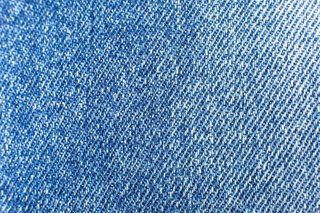 Materiaal blauwe hipsterjeans. denim doek textuur achtergrond.