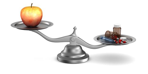 Medicijnen en appel op weegschaal