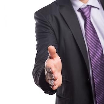 Medio sectie van zakenman die een handdruk aanbiedt