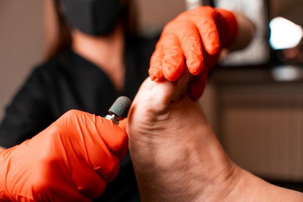 Medisch bureau, podologie, behandeling van voetproblemen, arts en patiënt, gezonde levensstijl