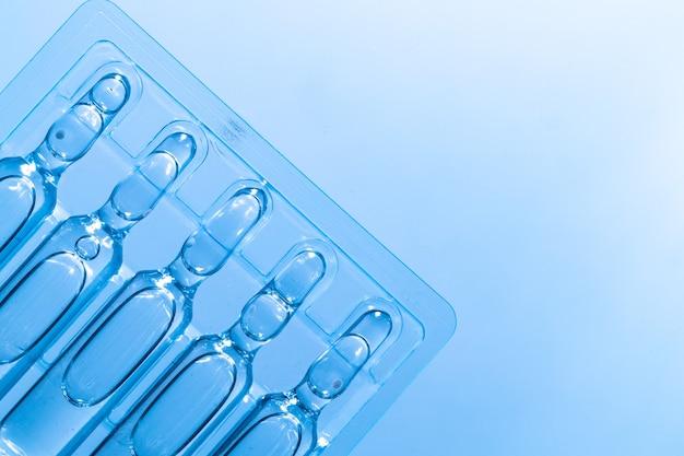 Medische achtergrond van gewone ampulflesjes voor injecties