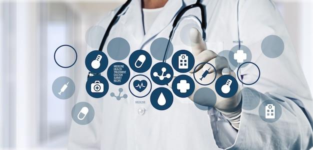 Medische pictogrammen en jonge arts met stethoscoop