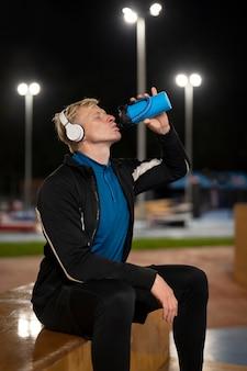 Medium shot man drinkwater