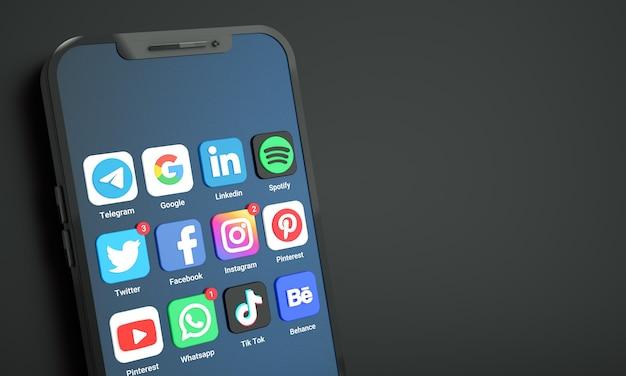 Meest populaire sociale media-pictogrammen en logo's op het scherm van de mobiele telefoon met kopieerruimte voor tekst