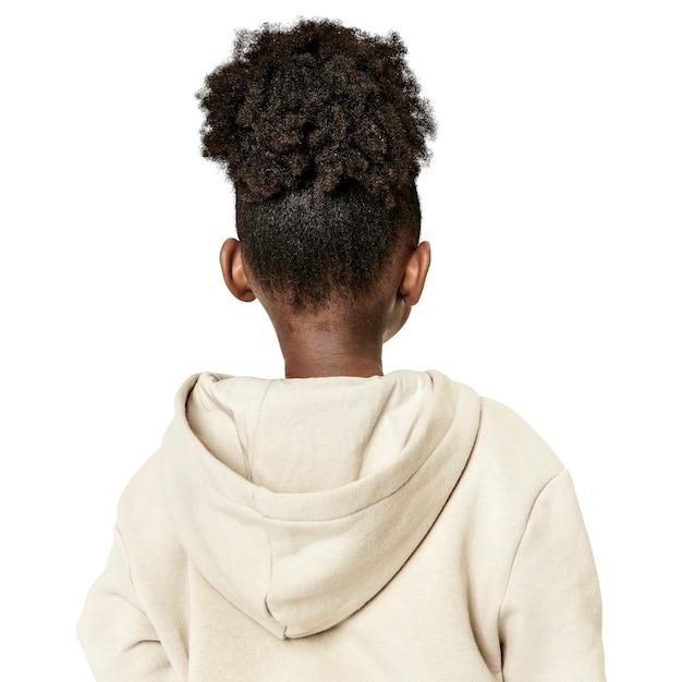 Meisje in een beige hoodie achteraanzicht