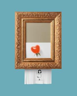 Meisje met een rijpe tomatenballon in de vorm van een hart in een vintage frame met een ornament op een blauwe achtergrond. zelfvernietigend beeld als symbool van moderne kunst