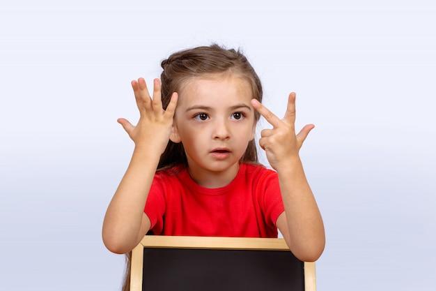 Meisje met schoolbord.