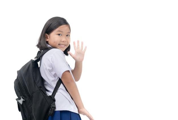 Meisje student naar school gaan en zwaaien vaarwel