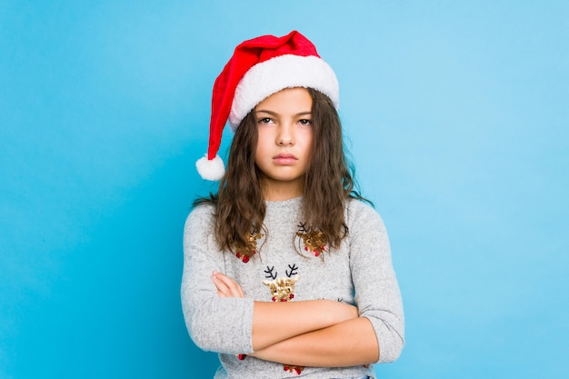 Meisje vieren kerstdag moe van een repetitieve taak.
