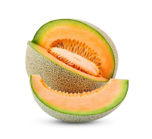 Meloen met zaden op witte muur