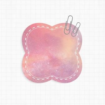 Memoblok met roze sterrenstelsel als achtergrond en paperclips