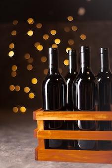 Mengsel van wijnflessen met bokeh