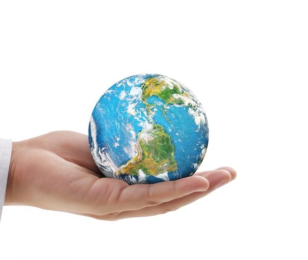 Menselijke hand met globe elementen van afbeelding geleverd door nasa