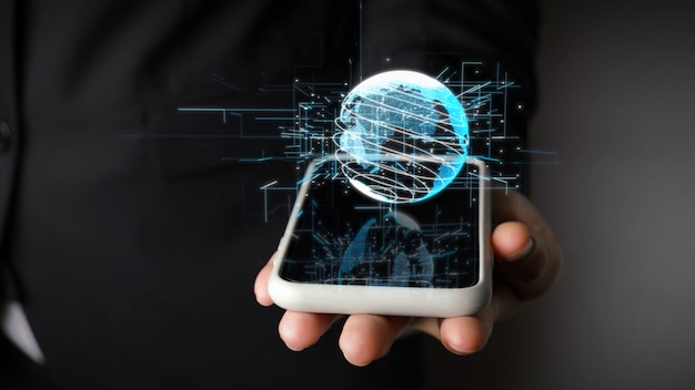 Menselijke hand met mobiele telefoon met earth globe holografische technologie