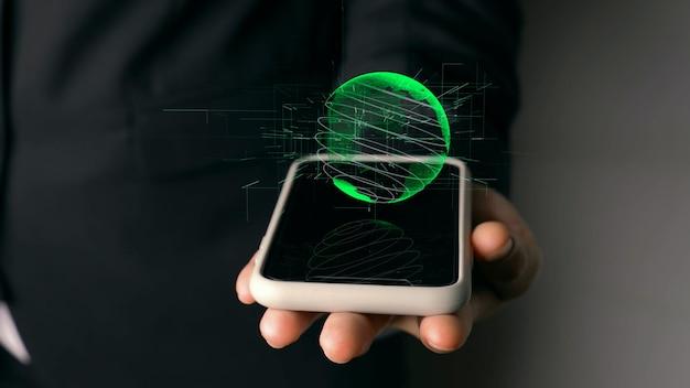 Menselijke hand met mobiele telefoon met holografische technologie van de aardebol