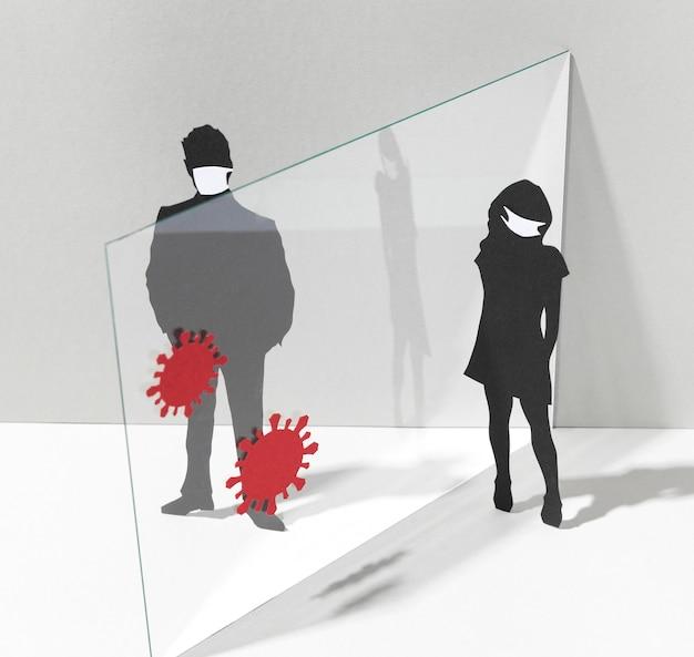 Mensen met medische maskers en glazen scheidingswand voor coronaviruspreventie